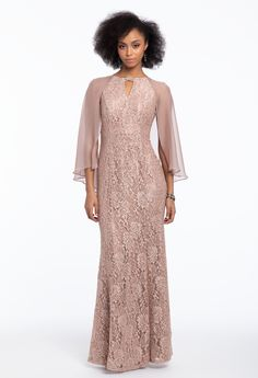 Jazz up your ensemble with stunning sequins this season! This mother of the bride dress features a keyhole neckline with a rhinestone clip, chiffon attached cape that's ideal for a church or outdoor ceremony, and a modified mermaid silhouette to accentuate your shape. Finish off your chic look with mid heel glitter rhinestone sandals and a satin evening clutch. #CamilleLaVie