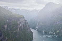 Mountains in Geiranger in a cloudy and foggy day seen from above, Norway
