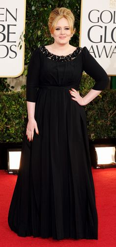 British singer Adele wearing a Burberry dress on the red carpet at the #GoldenGlobes in L.A. last night