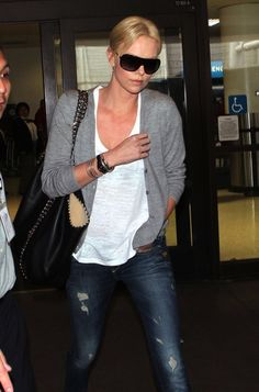 Charlize Theron in G-Star Skinny Jeans and Carrying Stella McCartney Tote Bag