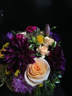 Bride's bouquet in purple tones, peach and a touch of yellow. Dahlias, peach roses, peach and violet mini carnations, phlox, chocolate lace. http://fleurieflower.com