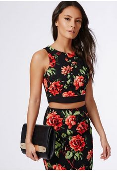 Swing into the season where moody blooms are high on the trend list. This black crop top with vibrant red rose print and exposed back zip makes this a feminine piece that you'll want to wear over and over again. Team with its matching midi ...