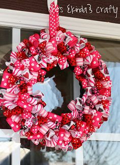 Valentine's Day Ribbon Wreath  Looks so pretty and festive!  Looks like I'll be stocking up on ribbon :)
