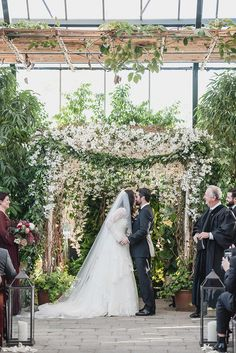 Vintage black tie fall Planterra Conservatory wedding. West Bloomfield, Michigan wedding photography at the Planterra Conservatory provided by Kari Dawson and her team.Details...Marjorie sat on top of a kitchen bar stool while her sister, maid of honor, make-up artist got to work. Marjorie's…