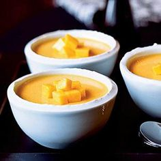 Orange mangoes symbolize gold and riches. Prepare and chill pudding the night before. Whip the cream just before serving, and allow guests to dollop some on their own desserts.
