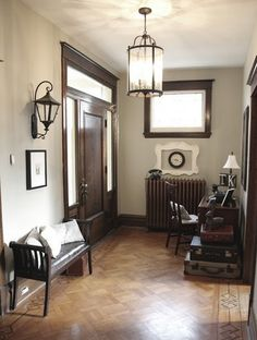 dark trim with grey walls.might be a great color to change to with all my dark wood trim: Room Colors, Wall Colors, House Colors, Great Room Paint Colors, Entryway Paint Colors, Basement Colors, Dark Wood Trim, Brown Wood, Revere Pewter Benjamin Moore