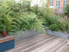 Galvanised steel planters on roof terrace