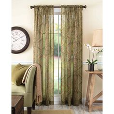 Better Homes and Gardens Tapestry Sheer Curtain Panel. Sage(ish) green with multicolor design. $13.97 per panel at WalMart.