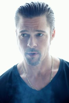 Brad Pitt.  Just recently jumping on the bandwagon.  Suppose the character for my book has his charm... Hmmm.
