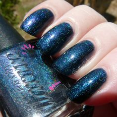 Bad is a deep indigo blue with a scattered holo and shifts to teal, blue and possibly purple