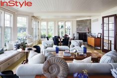 Jerry and Jessica Seinfeld's Hamptons House InStyle  Redo the window seat!!  Simple trim with hardware.