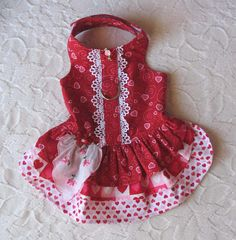 This little dress is perfect or Valentines Day or anytime. The bodice and first layer of the skirt are a red fabric with pink hearts. There is a