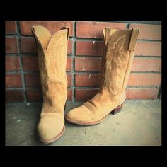 Gorgeous Vintage Lucchese Western Boots. Gorgeous Vintage Lucchese Men's size 9 1/2 Western Boots. Made in the USA. Leather with a subtle stitch embossed design enrich a laid-back cowboy boot set on a classic Western sole. Beloved by presidents, celebrities and the everyman, each Lucchese boot has been handmade with care since 1883. Lucchese Shoes Heeled Boots