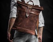 Cognac brown leather backpack with military hardware dated back to the WW2  Original Collection Roll top backpack
