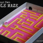 Maze made from staws, shirt box, and marble. great for working on supination and visual tracking.