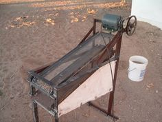 Sand Sifter by billybob_81067 -- Homemade sand sifter constructed from an electric motor, angle iron, pipe, pulleys, and a metal screen. http://www.homemadetools.net/homemade-sand-sifter