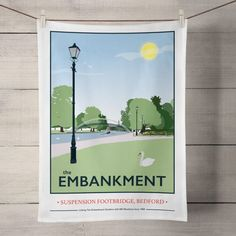 The Embankment Suspension Bridge, Bedford Tea Towel  £8.00  The Embankment Suspension Bridge, Bedford print is now available as a Tea Towel.  Designed by myself and professionally digitally printed and constructed in the UK on 100% Cotton Tea Towel complete with hanging loop. Tea Towel is packaged in branded packaging making it the perfect gift or treat for yourself! Tea Towel Dimensions: 45.5cm x 70cm. Wash care instructions: Wash Max 40 degrees.