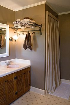 Upstairs bathroom wall color perhaps? With a cream color shower curtain and new mirrors...