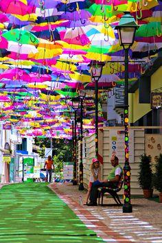 Canopies of Colorful Umbrellas and Beach Balls Cover Streets in Águeda, Portugal in a Month-Long Art Installation Umbrella Canopy Installation by Sextafeira Producoes Umbrella Street, Umbrella Art, Dubai Design Week, Colorful Umbrellas, Salon Art, Wow Art, Environmental Graphics, Outdoor Art, Color Of Life