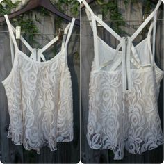 """Weekend ready tank that says """"WOW""""  American Rag brand ivory tank  Zipper closure  Fully lined  No Stains  Looks like new  75% Cotton, 25% Polyester"""