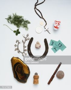 Stock Photo : Collection of lucky charms and talismans including a horseshoe, cross and clover leaf