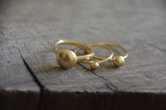 Check out this item in my Etsy shop https://www.etsy.com/il-en/listing/218583631/gold-nugget-stackable-delicate-ring