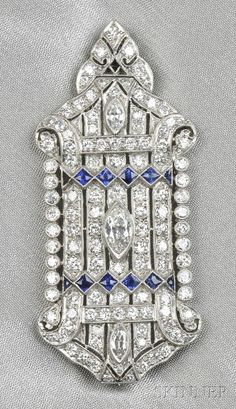 Art Deco Platinum, Sapphire, and Diamond Pendant/Brooch, set with marquise-cut diamonds, further set with transitional-cut diamond melee, approx. total wt. 1.95 cts., fancy-shaped blue sapphire highlights, millegrain accents, lg. 2 1/4 in.