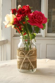 Mason jars decorated with burlap