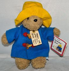 Classic Paddington Bear Soft Toy in a Blue Coat and Yellow Hat by Eden