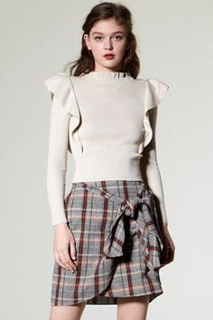 Grenda Ruffle High Neck Top Discover the latest fashion trends online at storets.com