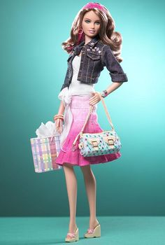 I may have long since outgrown barbies but I love this one...mainly for the miniature size Dooney & Bourke bag lol..