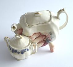 """Artist Ronit Baranga (previously) creates ceramic sculptural works she describes as existing on the """"border between living and still life""""—objects guaranteed to either tickle your funny bone or haunt your worst nightmares, depending on your perspective. Baranga depicts dishware as sprouting human fi"""