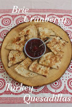 Brie Cranberry Turkey Quesadillas take the leftover bits of your cheese board, a little of that cranberry sauce and some sliced up turkey to create a whole new dish for the day after Thanksgiving or Christmas. #SundaySupper