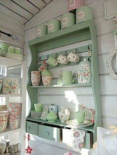 Country Cottage Style mint green hutch with floral pattern dishes