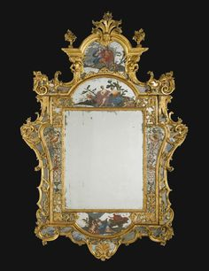 An Italian carved giltwood and reverse painting on glass mirror, Venetian the second quarter 18th century