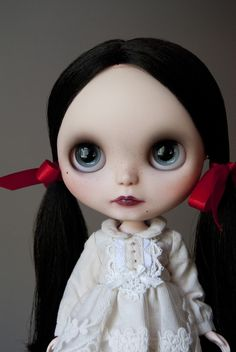Blythe Doll..she looks like Wednesday Addams!  But not wearing black...