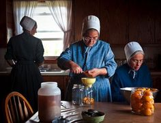 Amish - Women canning fruits and vegetebles
