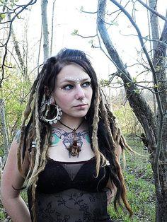 Dreads, bangs, giant earrings, harquus makeup, skull tattoo. :)