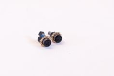 Silver earstuds with golden details and lava balls