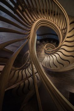 Atmos Studio's sinuous timber staircase spirals through the centre of London restaurant