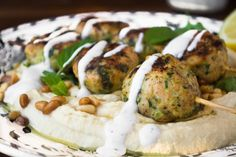 Hummus topped with juicy Turkey and Zucchini Meatballs make a wonderful light supper, just add pita bread!