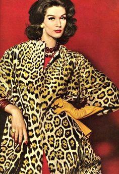 Simone D'Aillencourt in a leopard print coat, 1957
