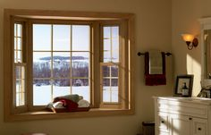 A bay window is the perfect place to cozy up during winter.