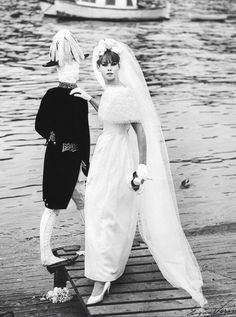 1961 A young Jean Shrimpton poses in wedding gown with wooden mannequin on the bank of the Seine in Paris, photo by Vernier for Jardin des Modes