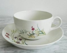 One (1) Coffee Cup and their Plate (1) for one total of two (2) pieces, Arabia Finland Pellervo Serie, Produced from 1949 to 1964 and Designed by Raija Uosikkinen. Pellervo is a pretty pretty serie, in White color with a Pattern of wild Smalls flowers in brilliant Purple, Pink, and leaves in Green, and baby Blue. Really beautiful hand painted vintage design. This pattern was produced from 1949 to 1964. Was a limited serie and is to hard to find. If you want more than one Cup and Plates, I…