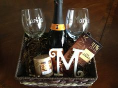Personalized wine basket for a bridal shower gift. Mr. & Mrs. wine glasses, bottle of wine, candle, chocolate, and a wooden letter for the brides future last name.