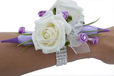 Purple Lisi Wrist Corsage designed with soft ivory roses and sparkling lilac diamante roses. Perfect wedding, prom and party wrist corsage £24