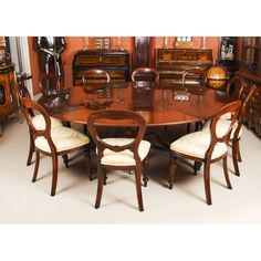 A fabulous dining set comprising a Regency Revival Jupe style flame mahogany dining table by William Tillman and a set of 10 dining chairs. Buy Dining Table, Mahogany Dining Table, Extendable Dining Table, Dining Set, Dining Chairs, Expanding Round Table, Mahogany Furniture, Romantic Bedrooms, Chair Height