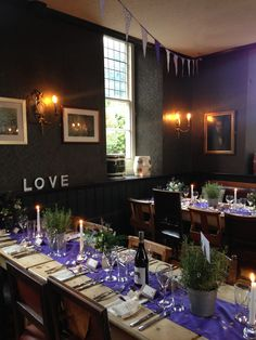 Long rustic tables with purple runners for the wedding breakfast at The Battleaxes. Pots of lavender, candlelight & flowers made a beautiful display. Styling: www.littleweddinghelper.co.uk