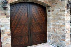 Faux Garage Doors (faux wood paint on metal garage doors!).  What a great idea!